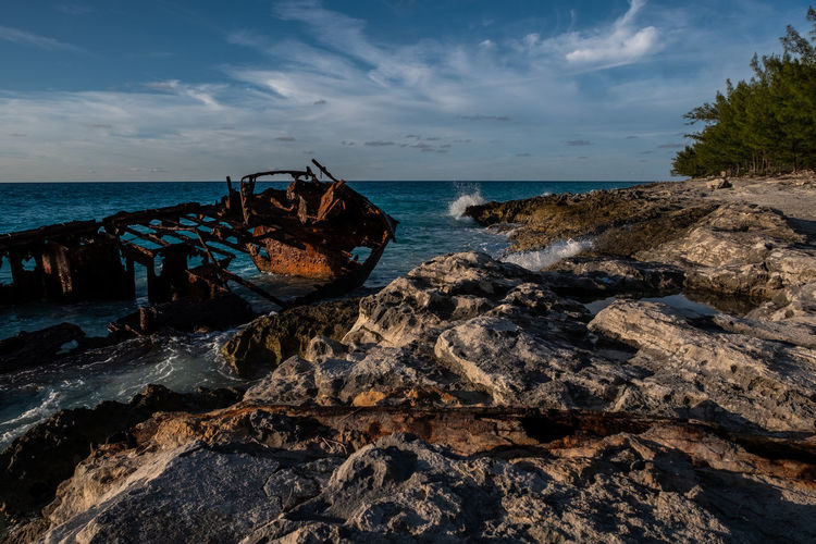 Rusted Skeleton Sea Sky Water Rock Land Rock - Object Beach Solid Nature Horizon Over Water Shipwreck Horizon Cloud - Sky Abandoned Scenics - Nature Damaged Obsolete Beauty In Nature Day Deterioration No People Outdoors Bimini