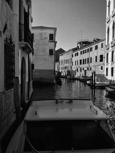 Canal in #Venice. Architecture Blackandwhite Boat Building Built Structure Canal City City Life Day Eyem Gallery Mode Of Transport No People Showcase April The Week Of Eyeem Water