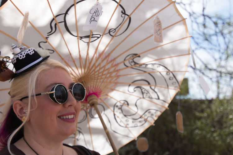 Blind parasol. PayPal Close-up Confidence  Convent Cosplay Decoration Design Detail Directly Above Dressup Fashion Happiness Metal Metallic Old Tucson Studios Parasol Pattern Person Press-Pass Spiral Steam Punk Sunglasses Tea Pots & Cups Tiny Hats Tucson Wild Wild West Steampunk Convention 5