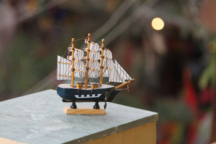 Close-up of toy boat on wall