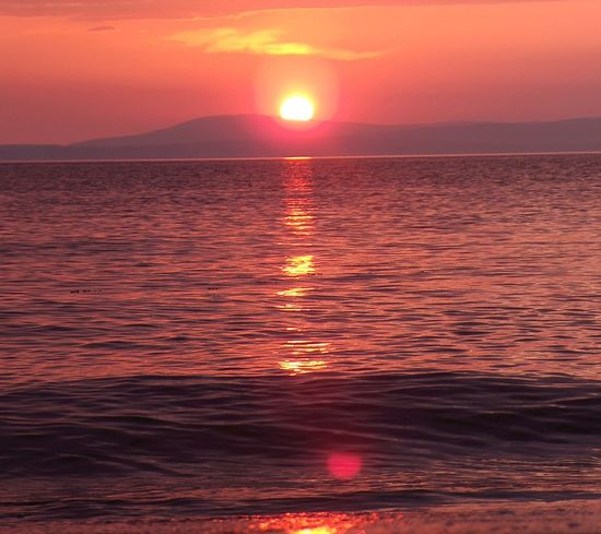 What Do You Think? Sunset Sea Horizon Over Water Water Sun Beauty In Nature Reflection Tranquility Outdoors Sky Sunlight Nature Scenics Dramatic Sky No People Tranquil Scene Refraction Heat - Temperature Beach Day People Eyeemphoto Myprofile EyeEm Gallery