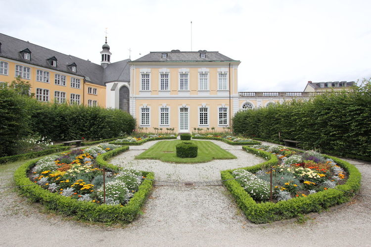 Panoramic view of garden and buildings against sky