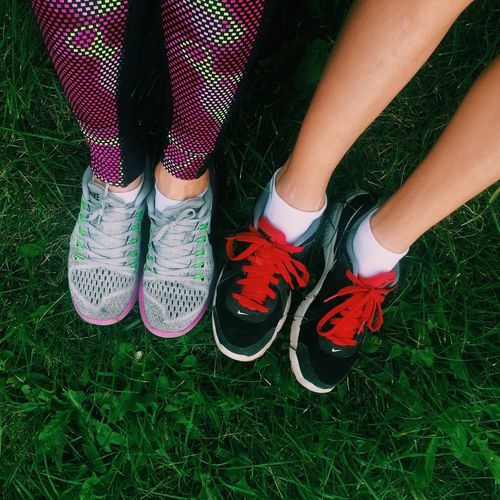 Low Section Person Grass Standing Shoe Footwear Human Foot Togetherness Person Field Outdoors Day Grassy Fashionable Green Color Footpath Running Running Club Nike Sommergefühle