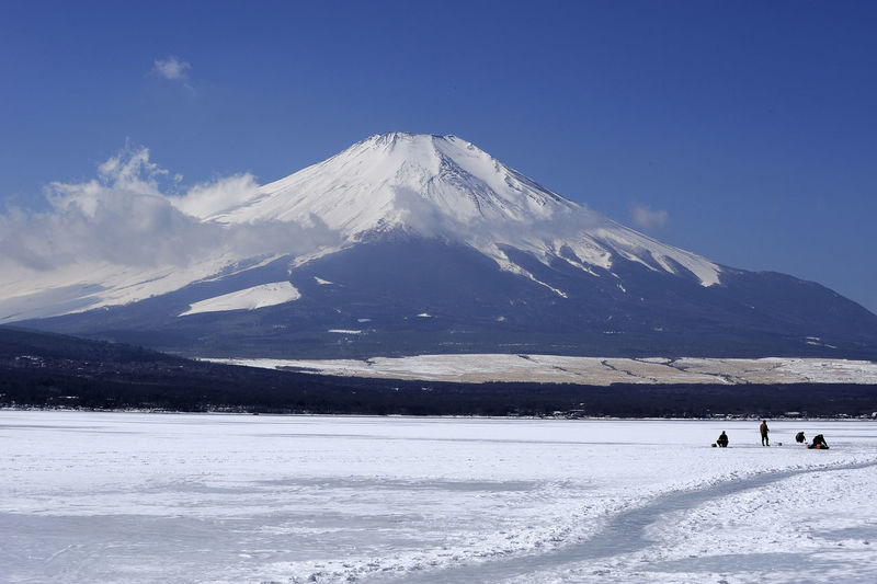 Ice fishing in front of Mt. Fuji ASIA Beauty In Nature Cold Temperature Day Frozen Lake Fujisan Hakone Ice Fishing Japan Lake Yamanaka Landscape Leisure Activity Mountain Mountain Range Mt. Fuji Nature Outdoors Sacred Mountain Scenics Snow Snowcapped Mountain Tranquil Scene Tranquility Winter Yamanakako