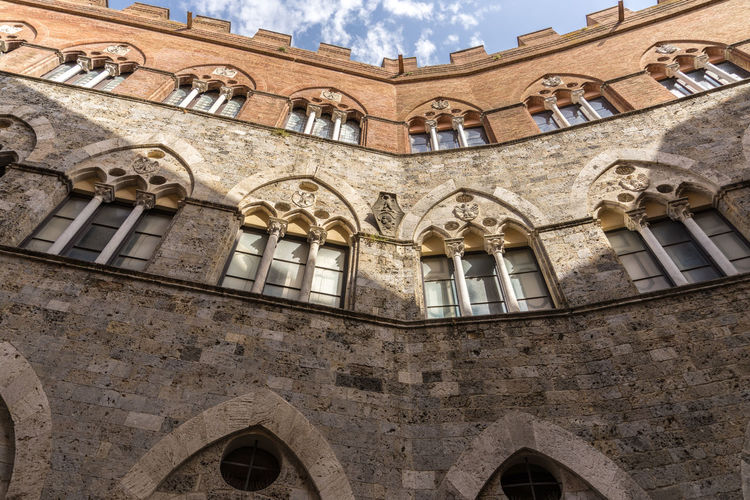 Shot in the city of Siena, Italy Arch Architecture Building Building Exterior Built Structure City Cloud - Sky Day History Low Angle View Nature No People Old Outdoors Sky The Past Travel Travel Destinations Wall Window
