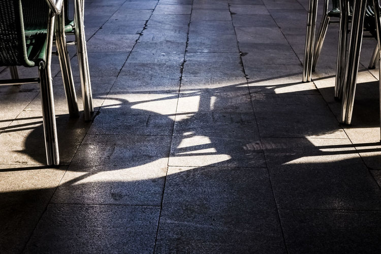 Shadow of a table and chairs on the ground at a terrazza in Madrid Spain. Dark Light Shadow And Light Travel Chairs Day Ground High Angle View Low Section No People Outdoors Shadow Sunlight Terrazza Tourism Tourist Destination Travel Destinations