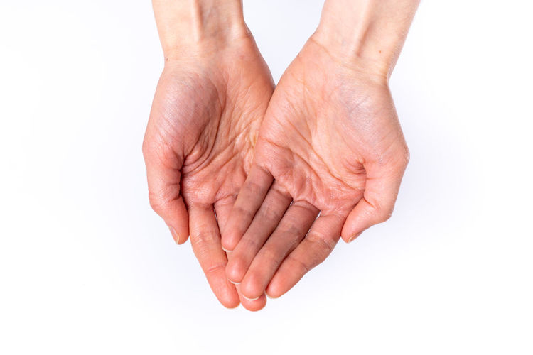 Cropped image of hand against white background