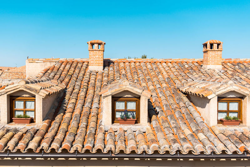 Day Daylight Outdoors Architecture Building Exterior Built Structure Building Window Sky Roof Residential District No People House Clear Sky Low Angle View Roof Tile Nature Blue Sunlight Old City Capture Tomorrow