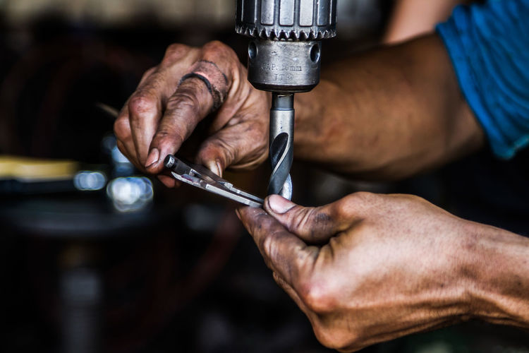 Craft Finger Focus On Foreground Hand Hand Tool Holding Human Body Part Human Hand Indoors  Industry Mechanic Men Occupation One Person Real People Repairing Skill  Tool Work Tool Working Workshop