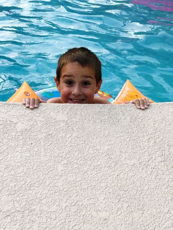 Summertime Looking At Camera Portrait Smiling Childhood Boys Leisure Activity Happiness One Person Day Fun Cheerful Elementary Age Outdoors Water Headshot Summer Beach Child One Boy Only People Pool Swimming Pool Swimming Smiling Face