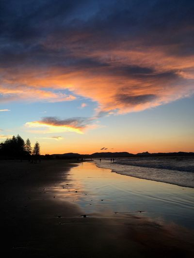 Sunset Water Tranquil Scene Scenics Tranquility Beauty In Nature Sky Cloud Calm Reflection Beach Majestic Idyllic Nature Non-urban Scene Vacations Travel Destinations Orange Color Tourism Dramatic Sky