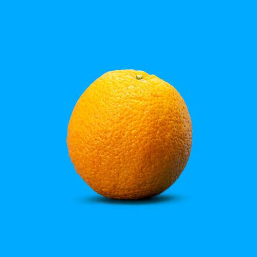 Close-up of orange against blue background