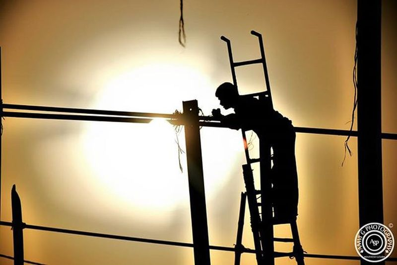©Amvi G Photography The Sun's Repair. This worker out there has been doing his work in extreme sunlight too. He had a Dark complection which he didnt had from birth but aqcuired gradually working like this. These people have to climb at heights and do a very risky job and what they get in return in negligible. To climb in a steep ladder and then hanging along a hot pole with sun right behind its back isnt an eqsy thing. May God Save them and may they reach the heights, not by a ladder but with their Skill.. @delhi_igers @delhigram @delhighted @natgeo @natgeoyourshot @1x5 @nikon_photography_ @photographers_of_india @ngphotocamp Worker Indian Photographers Photography Amvigphotography Delhi Delhiworker Instalike Picoftheday Picwithamaning Instagood Nikon D5300