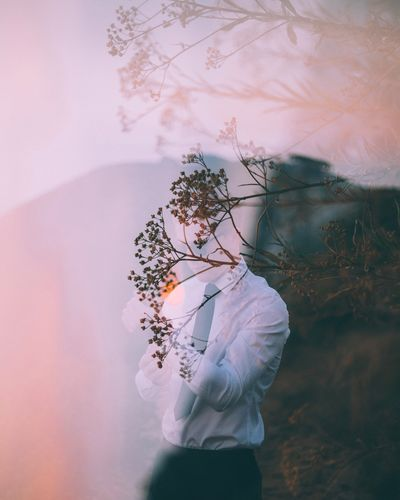 seeing double. One Person Flower Men Tree Nature Fragility Close-up Outdoors Beauty In Nature Flower Head Water Day People Double Exposure