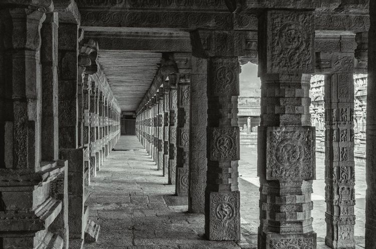 Pillar way. Architecture Old Narrow Weathered Obsolete No People Tourism Stone Carving Templesofindia Tamilnadu The Past South India Chola Architect History Place Of Worship Light And Shadows Black And White Monochrome