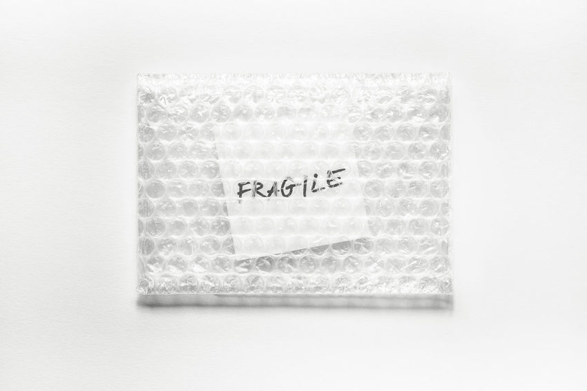 Plastic Bag Bubble Close-up Communication Fragile Hand Writing Handle With Care Pack Paper Studio Shot Text White Background