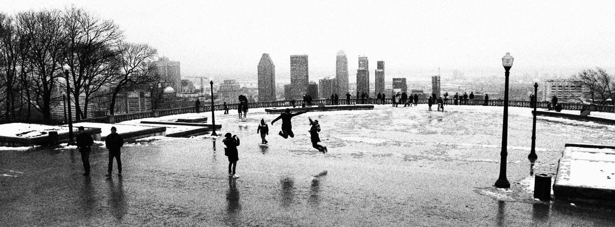 Montreal in winter Black & White Black And White Black And White Photography Black&white Blackandwhite Blackandwhite Photography Blackandwhitephotography Building Exterior Canada City City Cityscape Cityscapes Clear Sky Cold Temperature Day Jumping Montreal, Canada Montréal Outdoors Real People Skyline Square Tree Winter