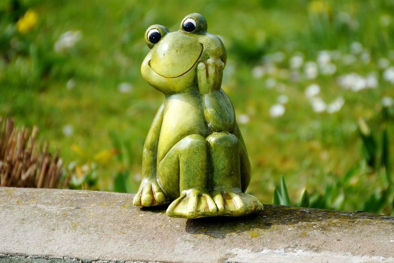 Close-Up Of Frog Green Decoration On Retaining Wall