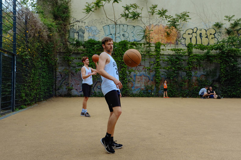 Adult Adults Only Ball Basketball - Sport Basketball Player Competition Court Day Friendship Full Length Leisure Activity Lifestyles Men Outdoors People Playing Real People Sky Sport Sports Clothing Sportsman Togetherness Tree Young Adult
