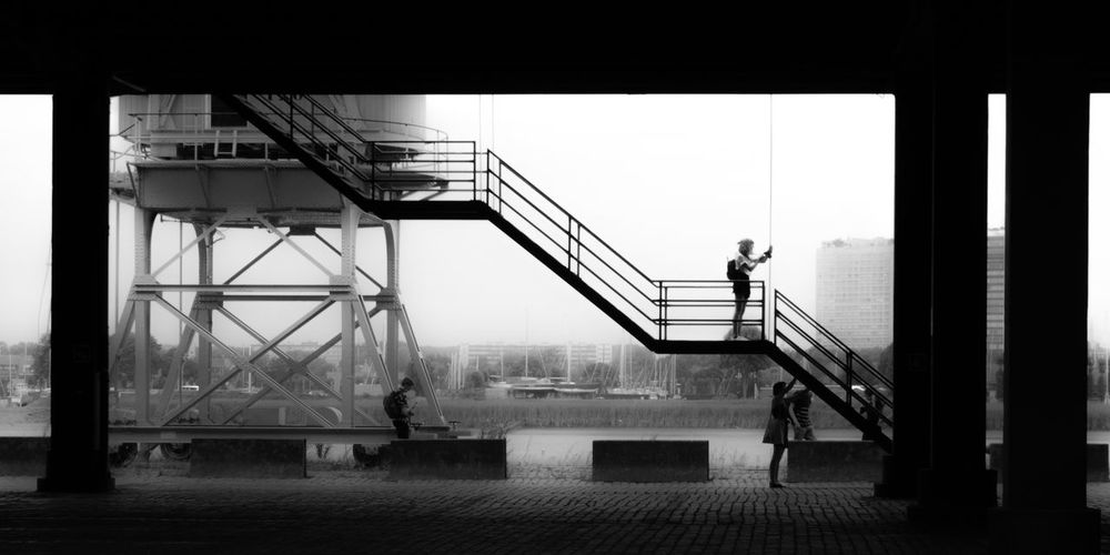 antwerp 09 Architecture Black And White Photography Building Exterior Built Structure Day Full Length Men Monochrome Outdoors People Railing Real People Silhouettes Sky Staircase Steps Steps And Staircases Urban Geometry Women Premium Collection Black And White Friday Be. Ready. EyeEm Ready   AI Now The Graphic City Mobility In Mega Cities The Art Of Street Photography