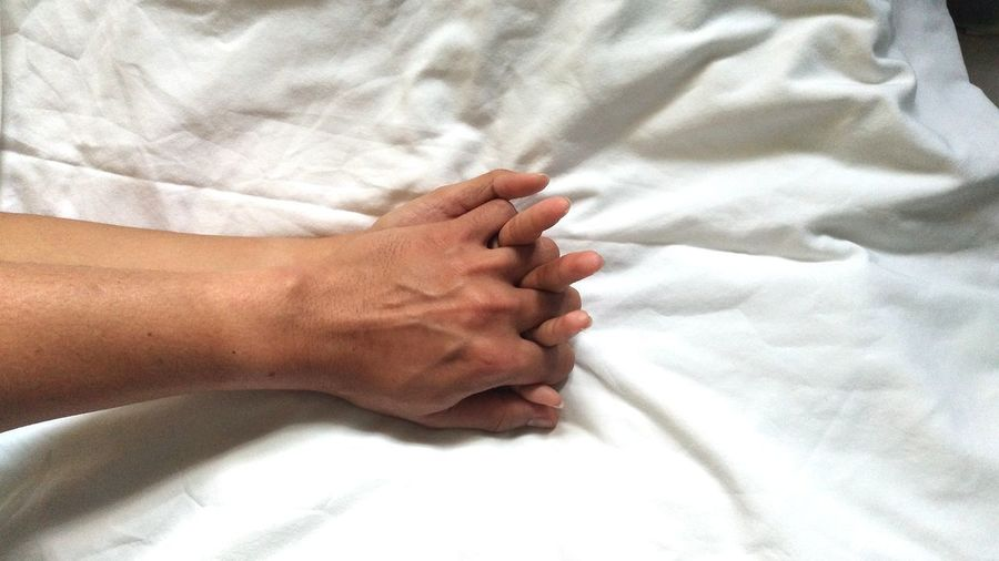 High angle view of person lying on bed