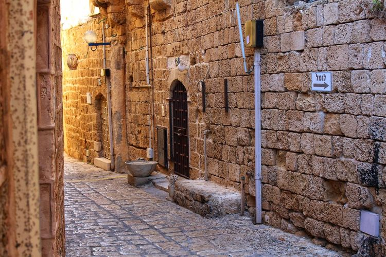 Jaffa Narrow Alley Ancient Ancient Civilization Arch Archaeology Architecture Bad Condition Building Exterior Built Structure Cobblestone Day Historic History Israel No People Old Old Ruin Outdoors Stone Material Stone Wall Tel Aviv Tourism Travel Destinations