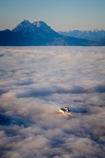 Fortress hohensalzburg rising above a sea of clouds, salzburg, austria
