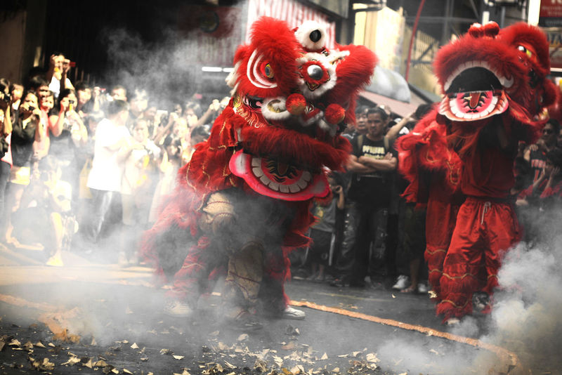 Dragon dance during Chinese New Year / Lunar Festical Celebration Celebration China Chinese Dragon Chinese New Year Close-up Cultures Dancing Dragon Dragon Fire Firecracker Gong Xi Fa Cai Kung Hei Fat Choi Lunar Festival Outdoors Performance Stage Costume Street Street Celebration Traditional Dancing Traditional Festival