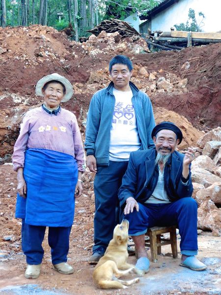I am 78 years old. Now I am able to build my first house. I am happy. - Please show me the place. - Here... we are sitting on the ground of my future! Looking At Camera Portrait Happiness Family In China poor Ancient Chinese Village The Portraitist - 2017 EyeEm Awards The Photojournalist - 2017 EyeEm Awards My Own House Building A House Sitting On The Ground Of My House China Lijiang Chinese China Photos Chinese People