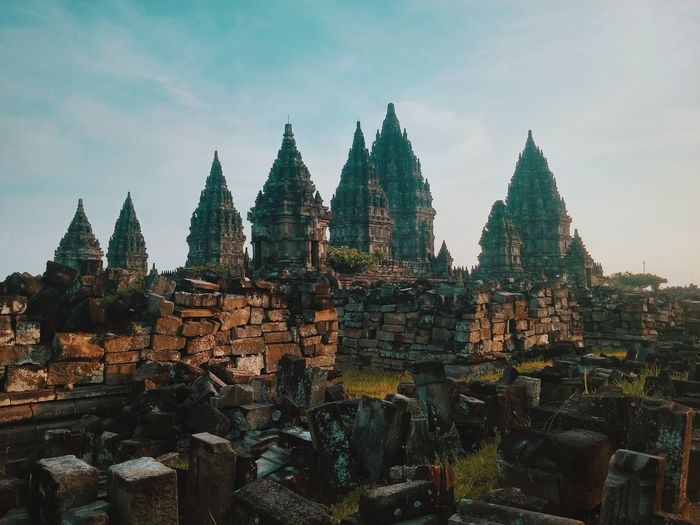 Panoramic view of temple against buildings
