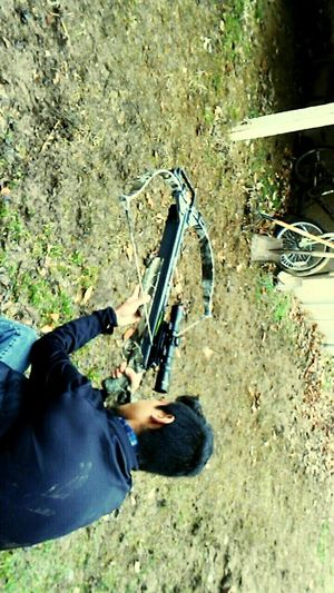Cross Bow Season Crossbow Dirt Kid Gun Weapon High Angle View One Person Rifle Adult Men One Man Only Real People Day Outdoors Camouflage Clothing