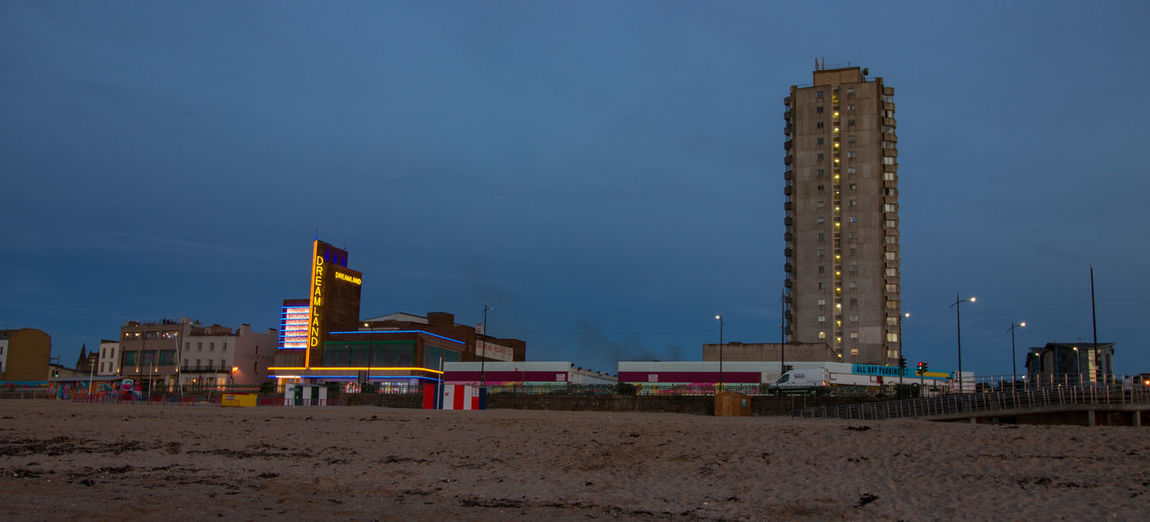 Dreamland, Margate Seafront, Margate, Kent, England. Architecture Built Structure Building Exterior Sky Land Beach Building Nature Sand City Office Building Exterior Tall - High Outdoors Skyscraper No People Tower Modern Travel Destinations Clear Sky Day Financial District  Seafront Dusk Vivid International Tourism Garden Of England Getty Images EyeEM Beach Photography Dreamland Beach Hut Swimming Sunset Architecture Council Flats