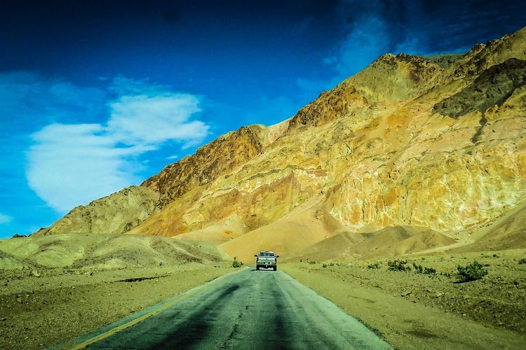 Lost In The Landscape Transportation Road The Way Forward Car Sky Cloud - Sky Mountain Land Vehicle Nature Scenics Mode Of Transport Beauty In Nature Outdoors Day Landscape Road Trip Tranquility Car Point Of View No People Death Valley National Park USA An Eye For Travel