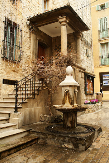 Architecture Bad Condition Building Building Exterior Built Structure Fountain Historic History Human Representation Low Angle View Old Railing Ruined Sculpture Staircase Stairs Statue Steps Valbonne Valbonne France Wall Window