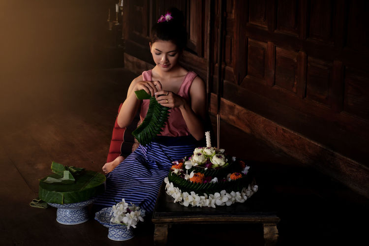 Young woman celebrating loi krathong