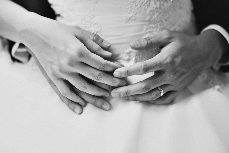 Black and white photography of wedding couple holding hands Human Hand Hand Human Body Part Real People Women Adult Midsection Body Part Indoors  Togetherness Bonding Two People People Love Emotion Positive Emotion Lifestyles Men Human Finger Finger Care Couple - Relationship Black And White Photography