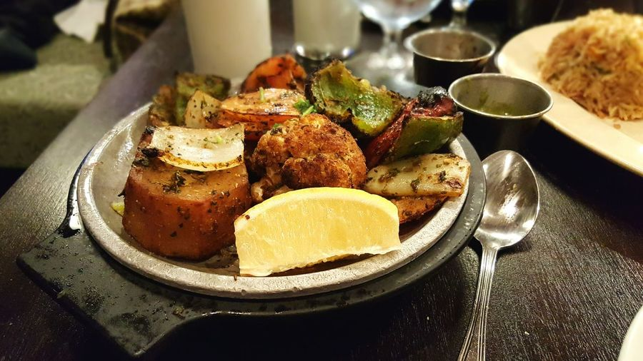 High angle view of roasted food served in container on table