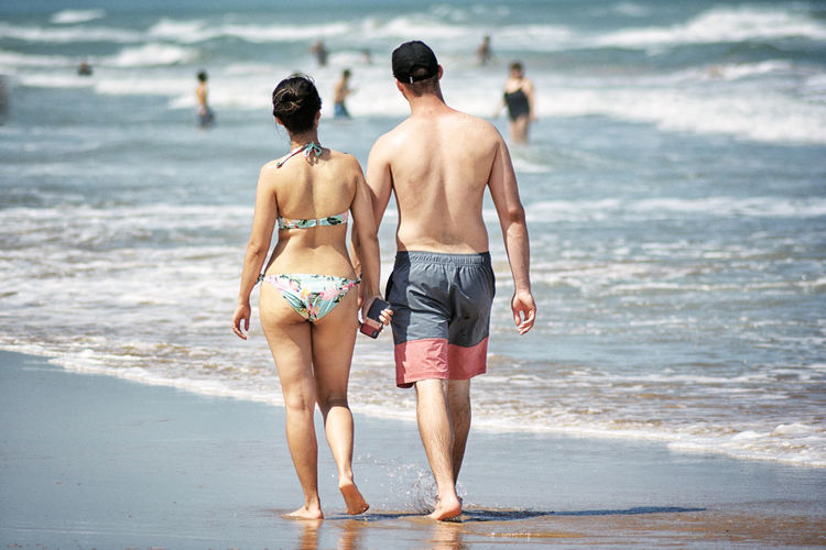 Couple Beach Full Length Holiday Land Leisure Activity Men Motion Nature Outdoors People Real People Rear View Sea Shirtless Shorts Swimwear Togetherness Trip Vacations Walking Water Women Summer Exploratorium The Traveler - 2018 EyeEm Awards Human Connection