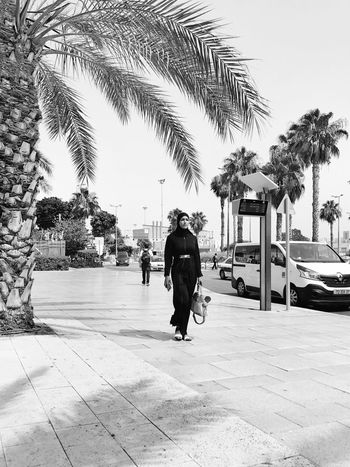 Palm Tree Tree Walking Day Outdoors Full Length Men Architecture City One Person People Adult IPhone7Plus מייאייפון7 Shotoniphone7plus EyeEm Selects מייסטריט מיישחורלבן מייבתגלים