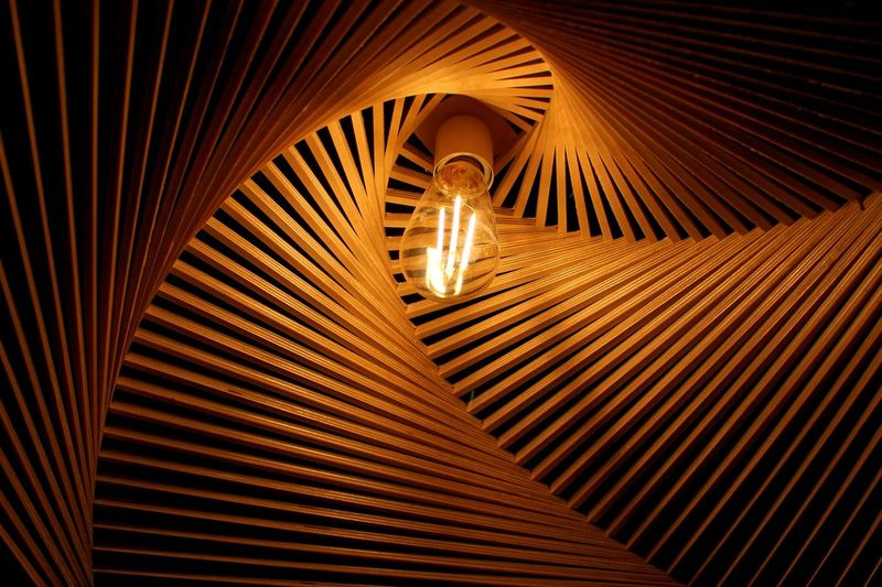 Low angle view of illuminated light bulb in decoration