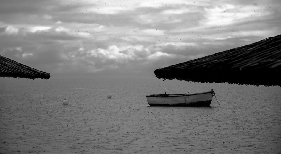 Rainy Days Beauty In Nature Black And White Boat Buoy On The Water Cloud - Sky Fishing Boat Horizon Over Water Mode Of Transport Nature No People Outdoors Scenics Sea Sky Transportation Water Waterfront Weather