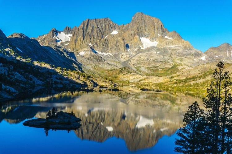 EyeEm Selects Garnetlake in Mammoth Lakes, CA Pinaceae Mountain Reflection Lake Scenics Mountain Peak Mountain Range Water Rock - Object Blue Nature Outdoors Beauty In Nature Sky No People Pine Tree Landscape Tree Travel Destinations Snow