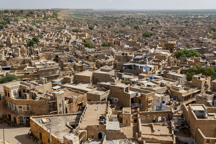 Jaisalmer 07 Cityscape Cloudy Sky Panoramic View Skyline The Golden City Tourist Attraction  UNESCO World Heritage Site Urban Exploration Urbanscape Architecture Building Exterior Built Structure Elevated View Famous Place High Angle View Jaisalmer Jaisalmer Fort Outdoors Rajasthan Sandstone Scenic View Sunny Day Tourism Travel Destination Viewpoint