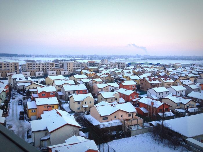 Snow covered residential district against sky