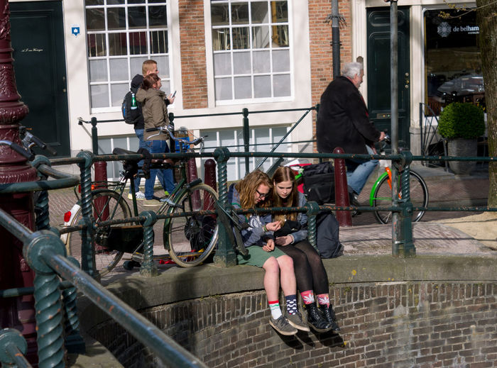 People riding bicycle in city