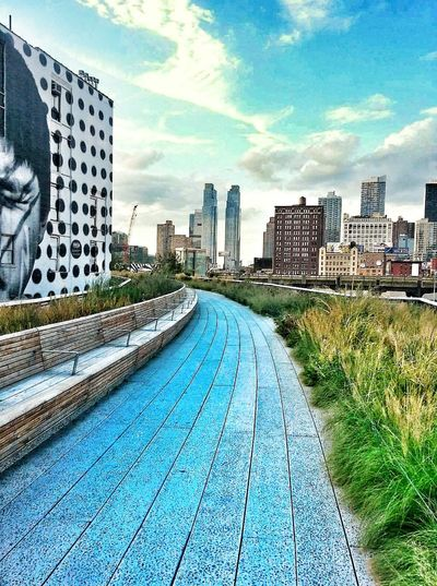 The Highline NYC Summer NYC Clouds Beautiful Day Views of The City No People Outdoors Plants Sky Buildings & Sky Taking A Stroll Note 5 Photography Highline Park Benches Mural No People Blue Sky Fluffy Clouds Battle Of The Cities TakeoverContrast The Street Photographer - 2017 EyeEm Awards The Great Outdoors - 2017 EyeEm Awards