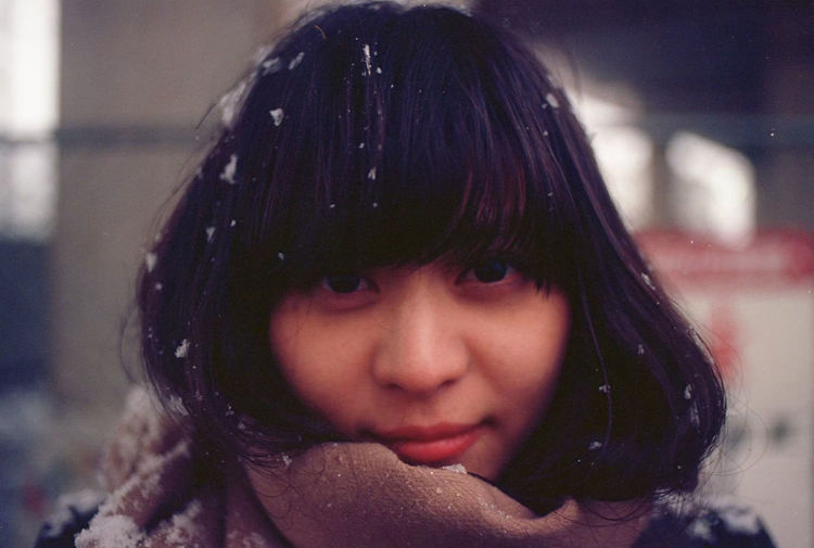 Close-up portrait of smiling woman during winter