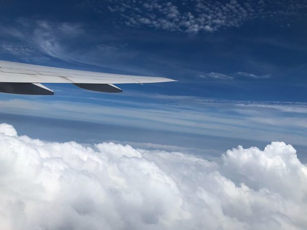 Cloud - Sky Sky Air Vehicle Airplane Transportation Flying Mode Of Transportation Outdoors Cloudscape No People Aerial View Aircraft Wing Nature Beauty In Nature Scenics - Nature Mid-air Day Motion Tranquility Travel