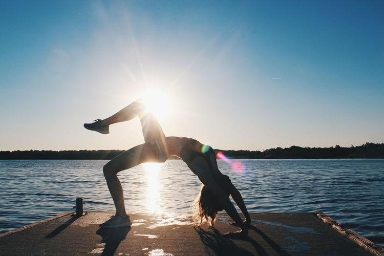Athleticism Water Sun Lake Exercising Sunlight Sunset Motion Activity Sky Summer Adventure Sport Sea Beach Yoga Girl Yoga Yoga Practice Yogalove Yogalife Yogapose Yogainspiration Yogaeverywhere This Is Strength EyeEmNewHere