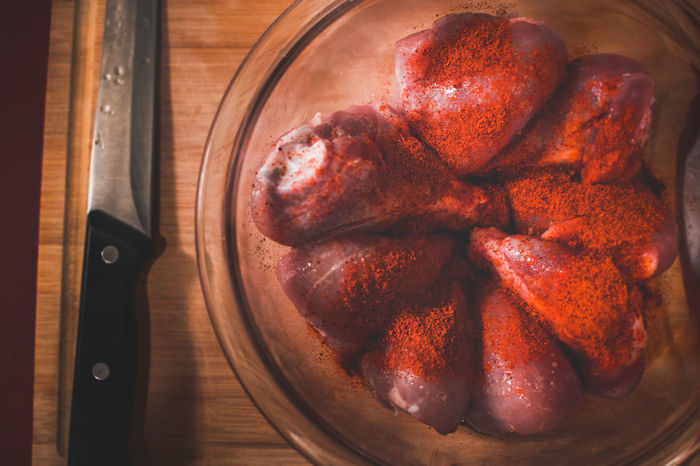 Seasoned Chicken Butcher Chicken Chicken Legs Chicken Masala Chicken Meat Close-up Cooking Dry Rub Food And Drink Fresh Freshness Indian Indoors  Ingredient Kitchen Knife Marinade Marinating Masala Meat Seasoning Spice Mix Spices Spicy Spicy Food